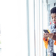 Portrait of young African-american Businesswoman using mobile phone near window in office - PhotoDune Item for Sale