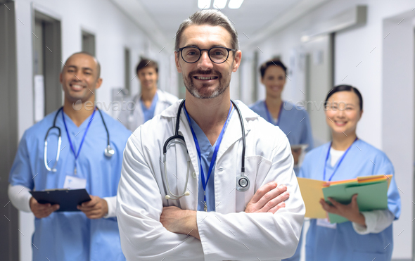 Diverse medical team of doctors looking at camera while holding clipboard and medical files - Stock Photo - Images