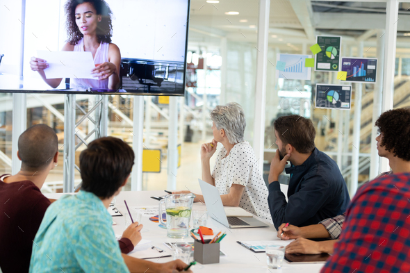 Diverse business people attending video conference - Stock Photo - Images
