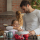 Happy Caucasian father and daughter preparing cookie on worktop in kitchen - PhotoDune Item for Sale