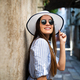 Smiling summer woman with hat and sunglasses on vacation - PhotoDune Item for Sale