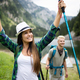 Group of happy friends with backpacks hiking together - PhotoDune Item for Sale