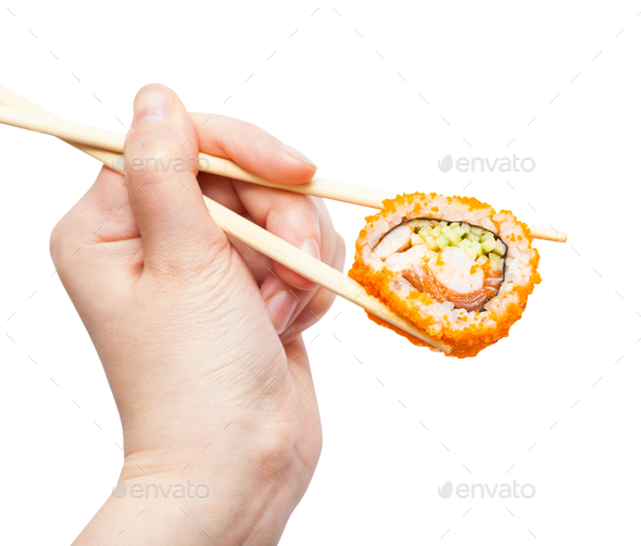 chopsticks hold california ebi roll isolated - Stock Photo - Images