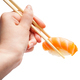 wooden chopsticks hold nigiri sushi with salmon - PhotoDune Item for Sale