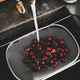 Fresh ripe garden cherries being washed in strainer, top view - PhotoDune Item for Sale