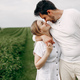 Beautiful couple spend time on a summer field - PhotoDune Item for Sale