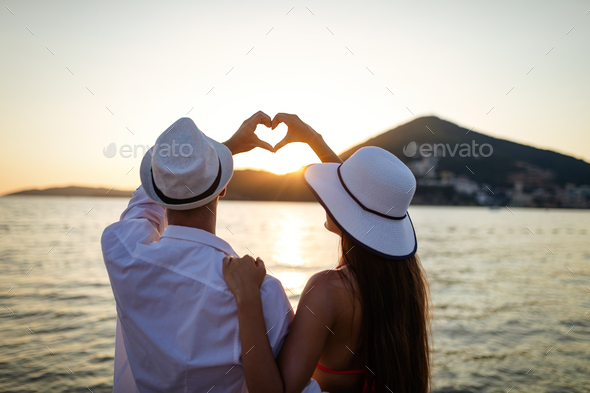 Happy couple in love walking on beach on honeymoon vacation - Stock Photo - Images