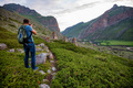 Male hiker takes photo of beautiful mountains and ancient tombs. North Caucasus - PhotoDune Item for Sale