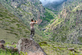 Male hiker takes photo of beautiful mountains in North Caucasus in summer - PhotoDune Item for Sale