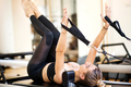 Woman lying on her back atop exercise bench - PhotoDune Item for Sale
