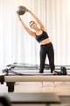Woman using exercise ball to stretch - PhotoDune Item for Sale