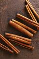 Cinnamon Sticks on the Brown Textured Table - PhotoDune Item for Sale