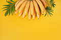 Bright Yellow Background with Bananas - PhotoDune Item for Sale
