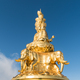 gold buddha against a blue sky - PhotoDune Item for Sale