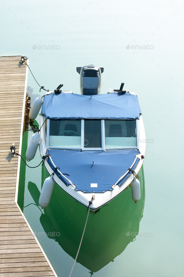 small boat on calm water - Stock Photo - Images
