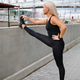 Beautiful and Flexible Blonde Woman Stretching In Modern City - PhotoDune Item for Sale