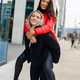 Smiling Female Friends Having Fun and Piggybacking In City Environment - PhotoDune Item for Sale
