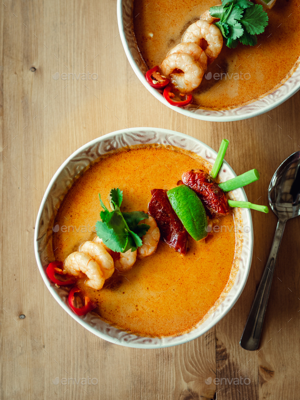 Tom yam kong or Tom yum soup on wooden table - Stock Photo - Images