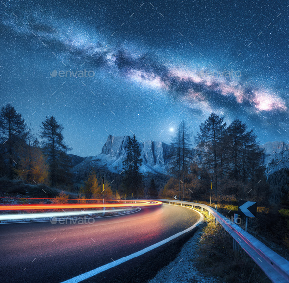 Milky Way over mountain road. Blurred car headlights - Stock Photo - Images