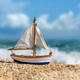 Miniature fishing boat at beach - PhotoDune Item for Sale