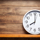 wall clock at shelf on wooden background - PhotoDune Item for Sale