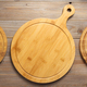 pizza cutting board at rustic wooden plank - PhotoDune Item for Sale