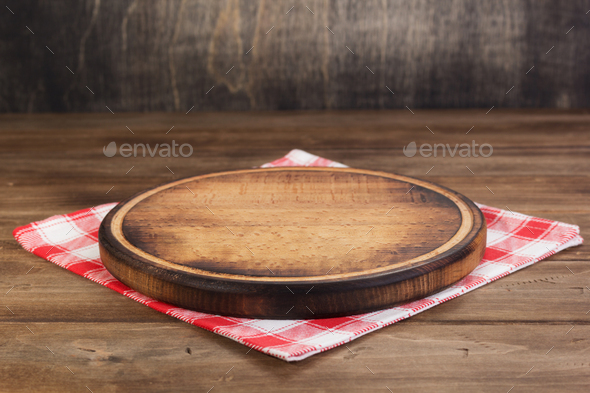 pizza cutting and napkin tablecloth at wooden table - Stock Photo - Images