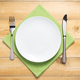 plate, knife and fork at wooden  background - PhotoDune Item for Sale