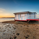 An old houseboat moored on the beach at Studland - PhotoDune Item for Sale