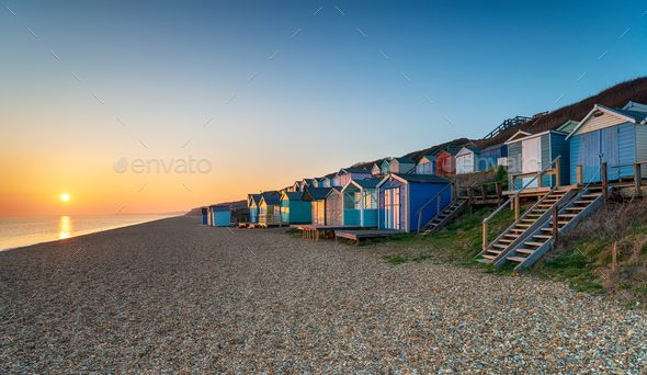 Rows of beach huts at Milford on Sea - Stock Photo - Images