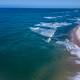 Drone picture of waves hitting the beach. - PhotoDune Item for Sale