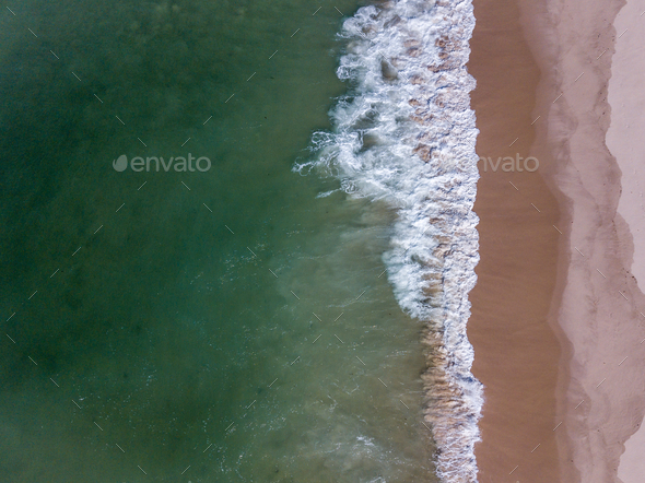 Drone picture of waves hitting the beach. - Stock Photo - Images