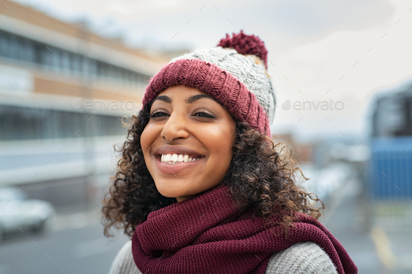 African woman wearing wool cap on winter - Stock Photo - Images