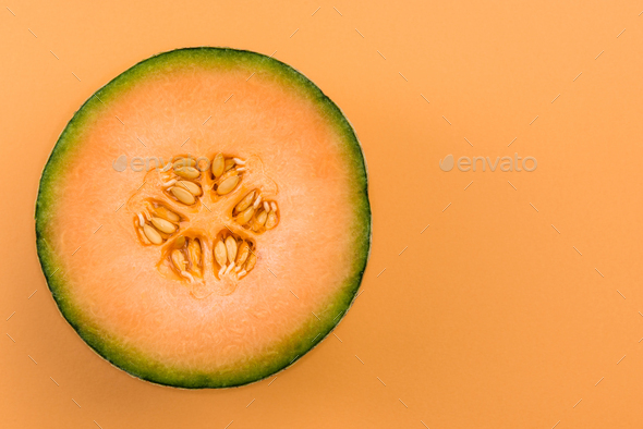 Cantaloupe Orange Melon Sliced In Half On Pastel Background Stock Photo By Merc67 Use them in commercial designs under lifetime, perpetual & worldwide rights. cantaloupe orange melon sliced in half on pastel background stock photo by merc67