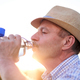 Senior hispanic man in summer hat drinking fresh water - PhotoDune Item for Sale