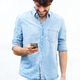 young man with listening to music with mobile phone and earphones - PhotoDune Item for Sale