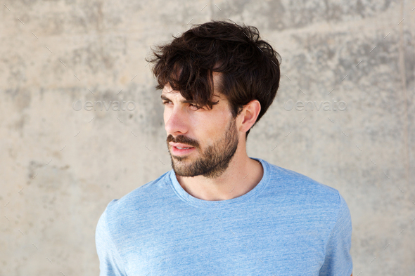 Close up handsome young man with beard - Stock Photo - Images
