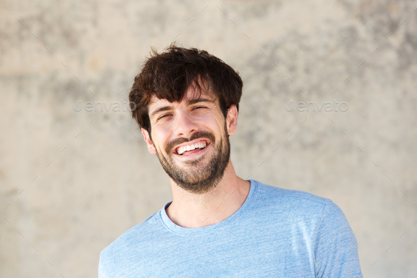 Close up smiling handsome man - Stock Photo - Images