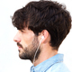 profile portrait of young man with beard listening to music with earphones - PhotoDune Item for Sale