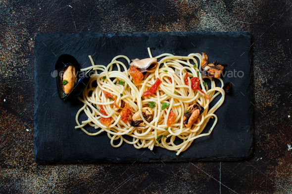 Spaghetti with mussels and tomatoes - Stock Photo - Images