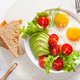 healthy breakfast flat lay. fried eggs, avocado, tomato, toasts - PhotoDune Item for Sale