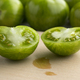 Halved green striped tomatoes - PhotoDune Item for Sale