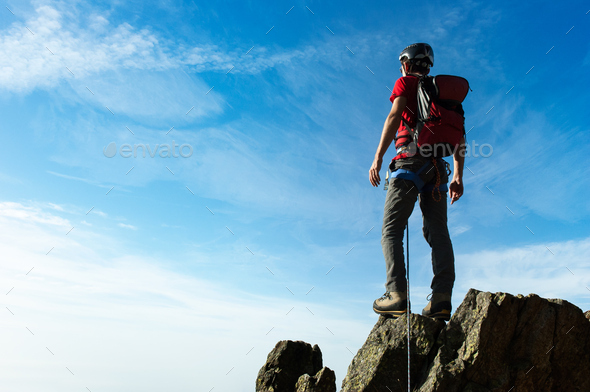 Climber arrive on the summit of a mountain peak. Concepts: victo - Stock Photo - Images