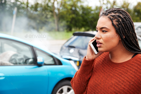 Female Motorist Involved In Car Accident Calling Insurance Company Or Recovery Service - Stock Photo - Images