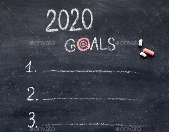 New year goals with items hanwriting on chalk board - Stock Photo - Images