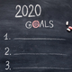 New year goals with items hanwriting on chalk board - PhotoDune Item for Sale