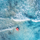 Aerial view of a young woman swimming with the donut swim ring - PhotoDune Item for Sale
