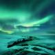 Aurora borealis over ocean. Northern lights in Teriberka, Russia. - PhotoDune Item for Sale