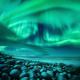 Aurora borealis over ocean. Northern lights in Teriberka, Russia - PhotoDune Item for Sale