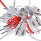 Unique red electric plug in the heap of a white plugs. Leadershi - PhotoDune Item for Sale